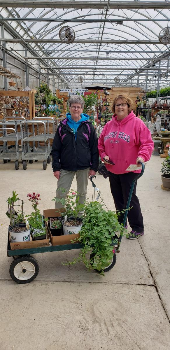 Master Gardeners visiting a greenhouse!